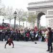PARIS - APRIL 27:: B-boy doing some breakdance moves in front a street crowd, at Arch of Triumph, April 27 2013, Paris, France — Stok fotoğraf