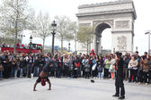 PARIS - APRIL 27:: B-boy doing some breakdance moves in front a street crowd, at Arch of Triumph, April 27 2013, Paris, France — Stock Photo