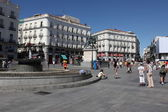 MADRID - JUNE 15: People at Puerta del Sol near monument to Carlos III, June 15, 2013, Madrid, Spain — Stock Photo