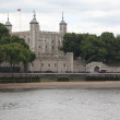 Tower of London on the Thames river with boat, UK — Stock Photo