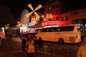 PARIS - MAY 3: The Moulin Rouge at night, on May 3, 2013 in Paris — Stock Photo
