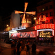 Stock Photo: PARIS - MAY 3: Moulin Rouge at night, on May 3, 2013