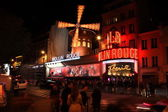 PARIS - MAY 3: The Moulin Rouge at night, on May 3, 2013 — Stock Photo