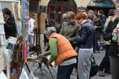 Public painter and buyer on Montmartre — Stock Photo