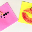 Yellow and pink sticker with the imprint of a red kiss — Stock Photo