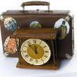 Antique clock face and retro suitcase — Stock Photo