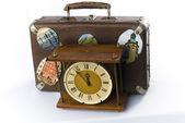 Antique clock face and retro suitcase — Stock Photo