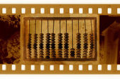 Old 35mm frame photo with vintage abacus — Stock Photo