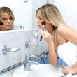 Woman during daily morning routines — Foto de Stock   #3138411