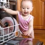 Baby at dishwasher — Stock Photo #3138447