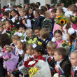 MOSCOW - SEP 1: Children with flowers in front of the School  — Stock Photo