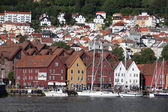BERGEN, NORWAY - CIRCA: Tourists and locals stroll along the UNESCO World Heritage Site — Stock Photo