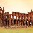 Whitby Abbey castle, ruined Benedictine abbey sited on Whitby's — Stock Photo #31770375