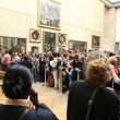 "PARIS - MAY 3: Visitors take photo of Leonardo DaVinci's ""Mona Lisa"" — Stock Photo"