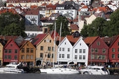 BERGEN, NORWAY - CIRCA : Tourists and locals stroll along the UNESCO World Heritage Site — Stock Photo