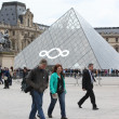 People go to famous Louvre museum — Stock Photo #32843603