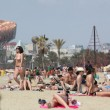 Crowded beach with tourists and locals in summer — Stock Photo