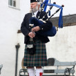 Unidentified Scottish Bagpiper playing music with bagpipe — Stock Photo