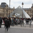 Stock Photo: PARIS - APRIL 27: People go to famous Louvre museum on April 27,
