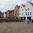 Stock Photo: BERGEN, NORWAY - CIRCJULY 2012: Tourists and locals stroll alo