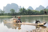 Chinese man fishing — Stock Photo