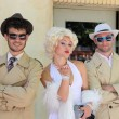 Impersonator Marylin Monroe and boys — Stock Photo
