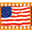 Vintage old 35mm frame photo film with USA flag — Stock Photo #35403337