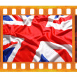 Vintage old 35mm frame photo film with UK, British flag, Union J — Stock Photo