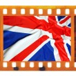 Vintage old 35mm frame photo film with USA flag — Stock Photo #35403471