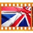 Vintage old 35mm frame photo film with UK, British flag, Union J — Stock Photo #35403609