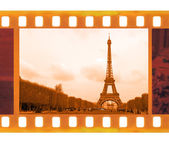 Vintage old 35mm frame photo film with Eiffel Tower in Paris — Stock Photo