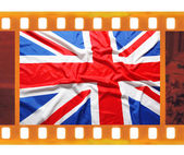 Vintage old 35mm frame photo film with UK, British flag, — Stock Photo
