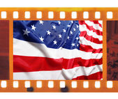 Vintage old 35mm frame photo film with USA flag — Stock Photo