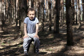 One boy in forest — Stock Photo