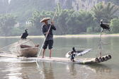 Chinese man fishing — Stock Photo