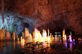 Frozen water Stalagmite in deep marble cave, Russia — Stock Photo