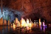 Frozen water Stalagmite in deep marble cave, Russia — Foto de Stock