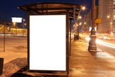 Blank sign at bus stop in city — Stock Photo