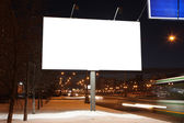 Empty roadside billboards at evening in city — Stock Photo