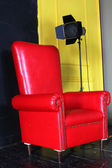 Red big armchair with studio light — Stock Photo