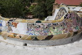 Fragmenes of Gaudi's mosaic work in Park Guell in Barcelona, Spain — Stock Photo