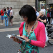 Стоковое фото: Tourists on streets of Barcelona