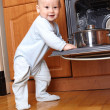Stock Photo: Child 1 year old in the kitchen cooking breakfast