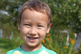 Portrait of a funny little boy 3-4 year old outdoors — Stock Photo