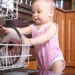 Funny child in the kitchen — Stock Photo #41959975