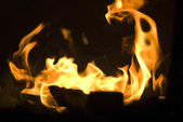 Burning and glowing pieces of wood in Fireplace — Stock Photo