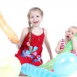 Adorable little two sisters 8 year and  11 month old with air ballon — Stock Photo #45274043
