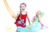 Adorable little two sisters 8 year and  11 month old with air ballon — Stock Photo