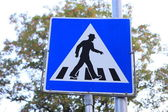 Funny pedestrian crossing sign in hat — Stock Photo