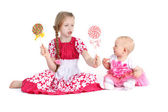 Adorable little two sisters 8 year and  11 month old  with candy — Stock Photo
